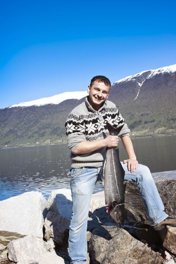 Fishermann e salmoni fotografia stock