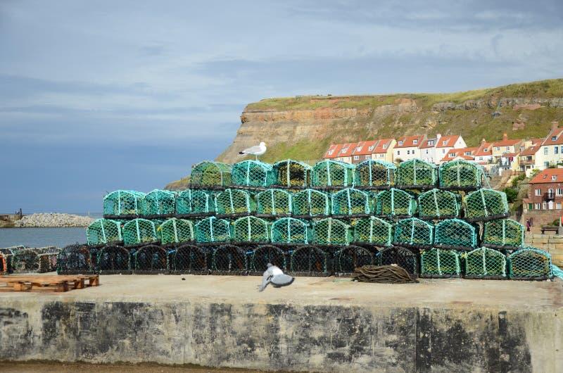 Fishermans虾笼在船坞边 免版税库存照片