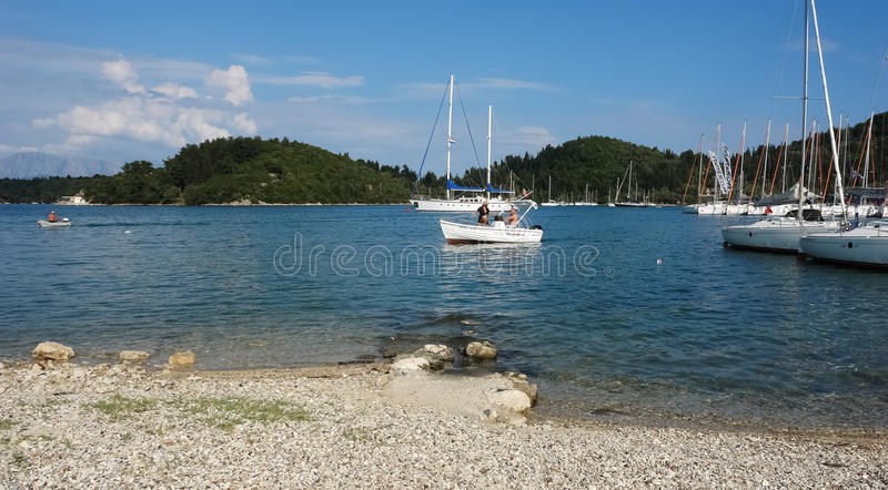 Fishermans in blue harbour. royalty free stock image