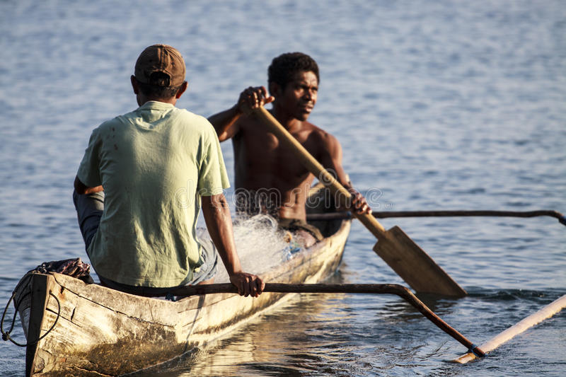 Fishermans in a boat royalty free stock photos