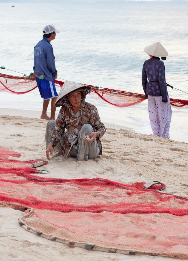 Fishermans dragging fishing nets stock photo