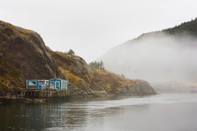 Fisherman's house by the sea. Rustic fisherman's colorful house by the sea with fog in Newfoundland royalty free stock photos