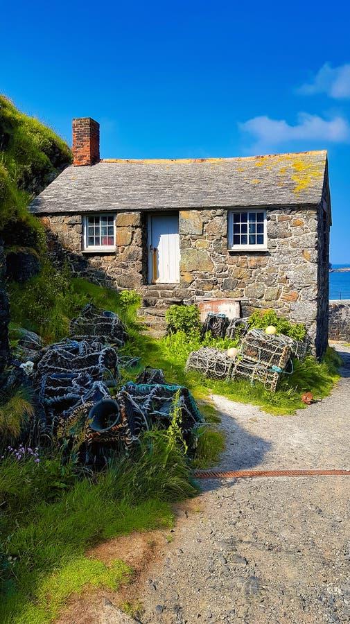 Fishermans pequenos casa de campo e potenciômetros de lagosta fotografia de stock