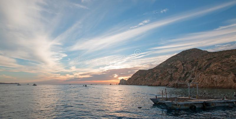 Fishermans sunrise view of bait supply boat at Lands End in Cabo San Lucas in Baja California Mexico. BCS stock photo