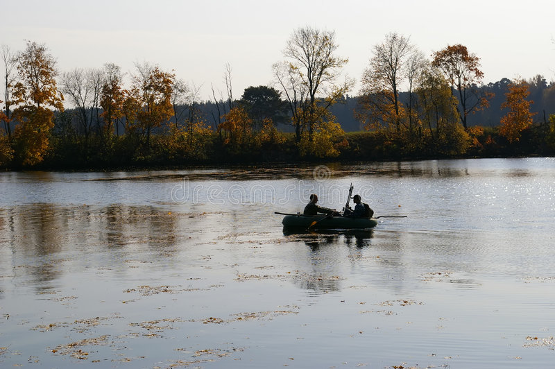 Fishermen. On small river in wood royalty free stock photography
