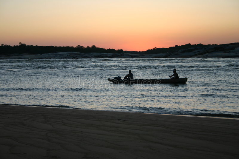 Fishermen in the Amazon. Fishermen on their way back home after fishing in the Orinoco river in the Amazon between Venezuela and Colombia stock image