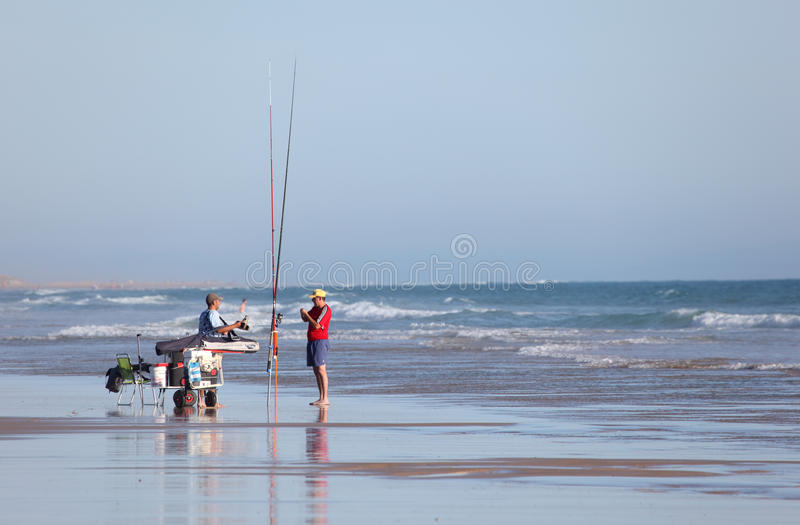 Download Fishermen on the beach editorial stock photo. Image of hobby - 25534383