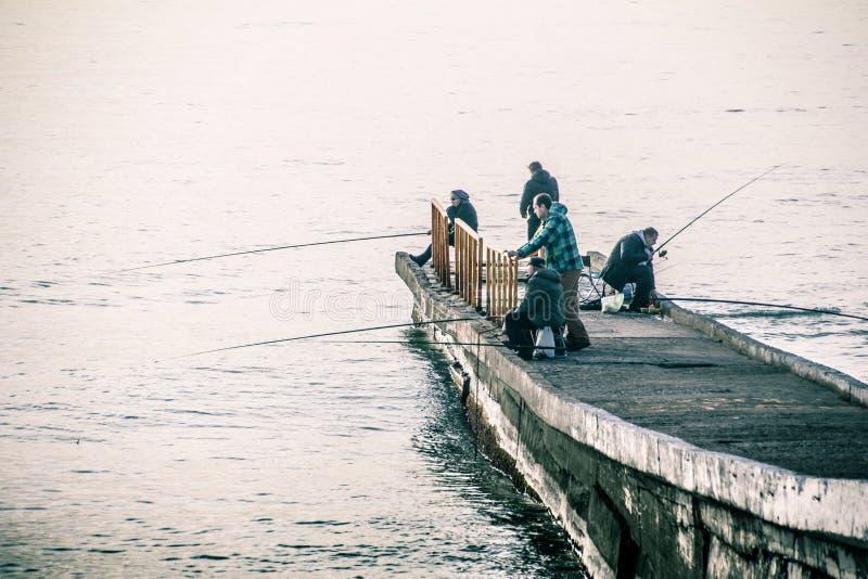 Fishermen on the black sea. Sochi sea port. street fishermen. pier. Central embankment of Sochi. Evening Sochi. Pier royalty free stock photos