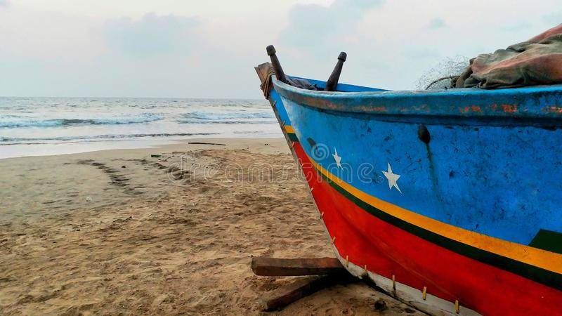 Fishermen boat on beach waiting for sailing royalty free stock photo