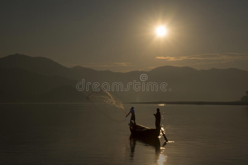 Fishermen on boat fishing early morning royalty free stock photography
