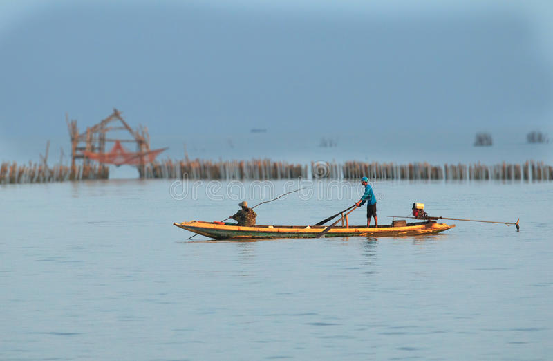 Fishermen on a boat in the morning. stock photo