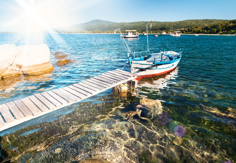 Download Fishermen Boat In Sithonia, Northern Greece Stock Photo - Image of stone, harbor: 39506902