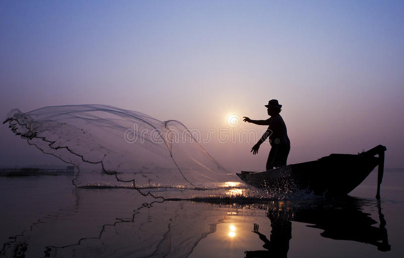 Fishermen are catching fish with a cast net stock image for Fish catching net