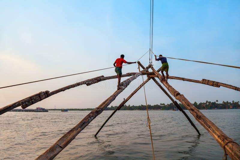 Fishermen and chinese fishing nets royalty free stock photo