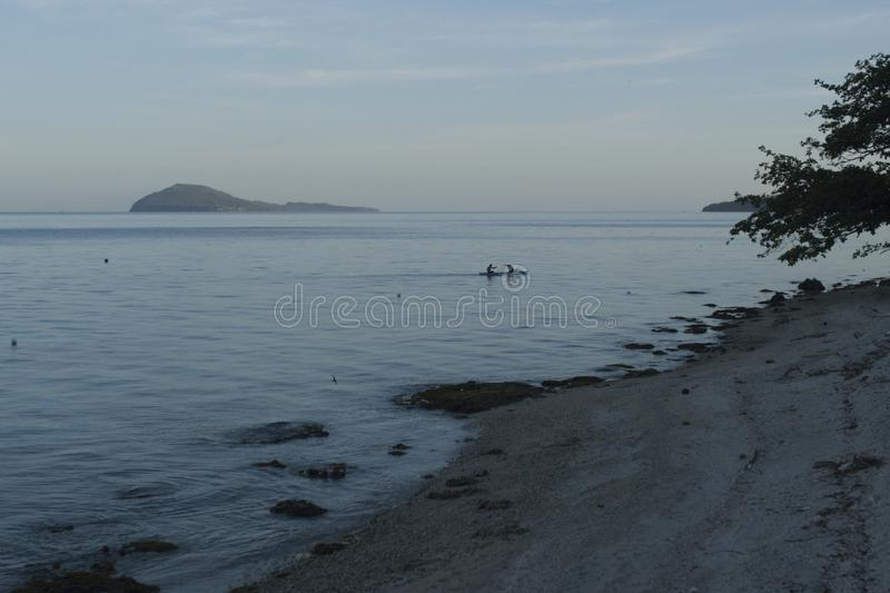 Fishermen coming back at Dusk in Padre Burgos, Leyte, Philippines. The diving around the small but vibrant town of Padre Burgos, is a real paradise for divers royalty free stock photo
