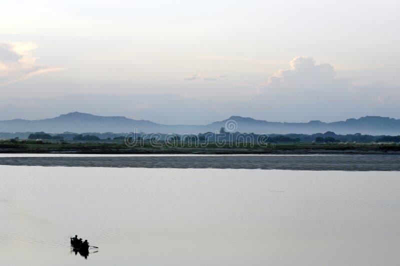 Download Fishermen Crossing Inle Lake In Burma Royalty Free Stock Photography - Image: 11809327
