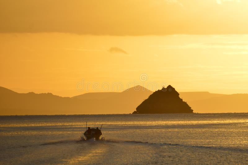 Fishermen into December Sunrise Bahia Concepcion, Baja California, Mexico stock photo