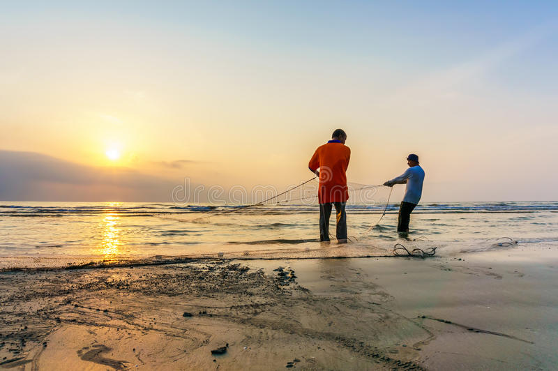 Fishermen do their work near Beserah beach, Kuantan, Malaysia stock photo