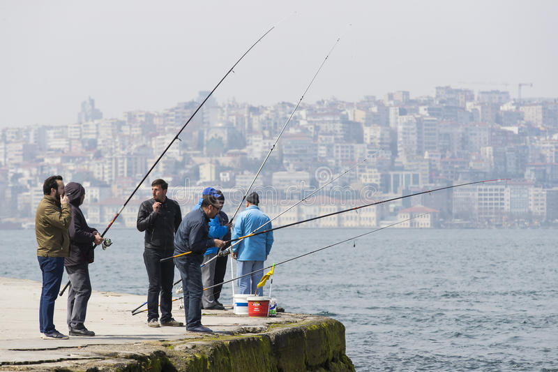 Fishermen are fishing on the banks of the Bosphorus in Istanbul Turkey royalty free stock images