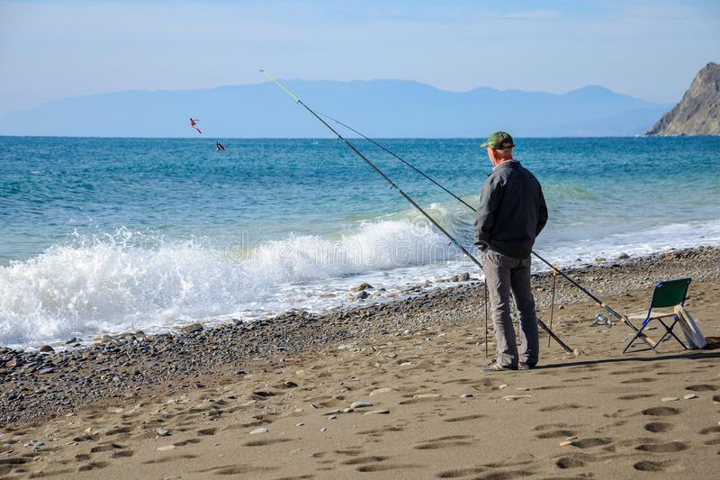 Fishermen fishing on the beach occupation for men stock photography
