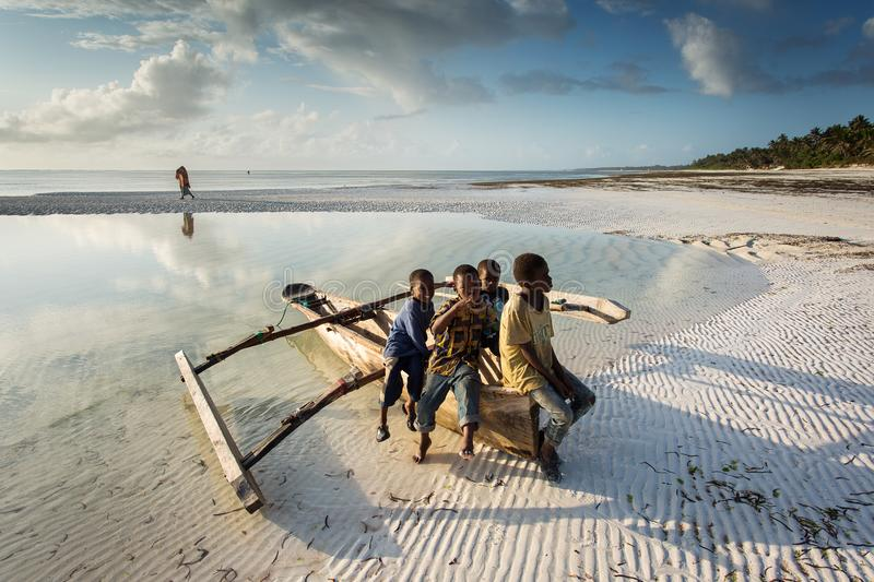Fishermen going on ocean on traditional fishing boat in Zanzibar stock photo