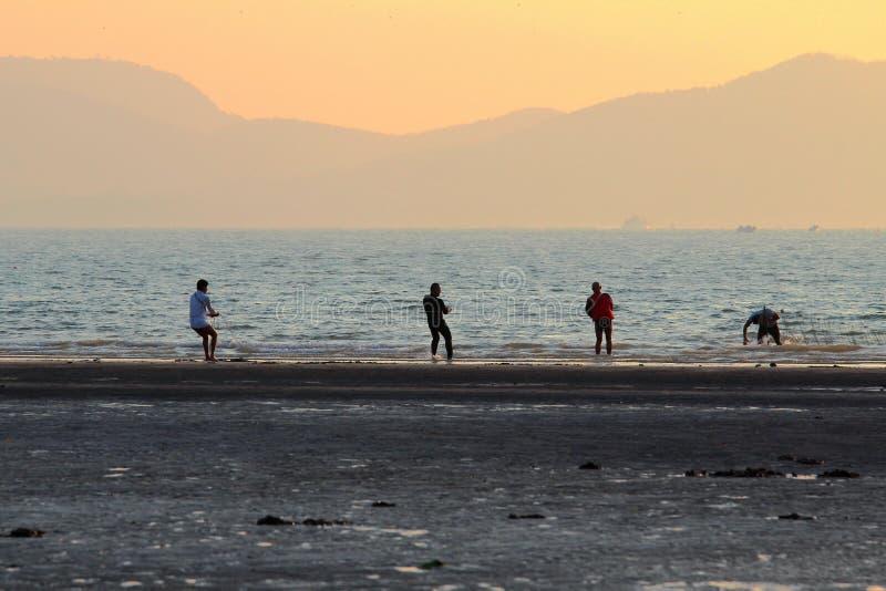 The fishermen hade a good haul on the beach. Qingdao, China, sunset, the fishermen hade a good haul on the beach stock photography