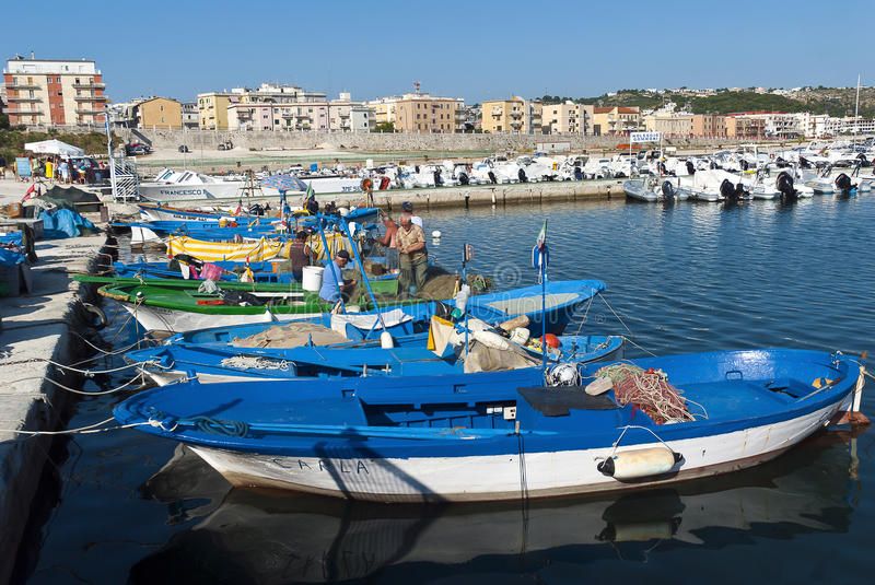Fishermen in the harbour stock photography