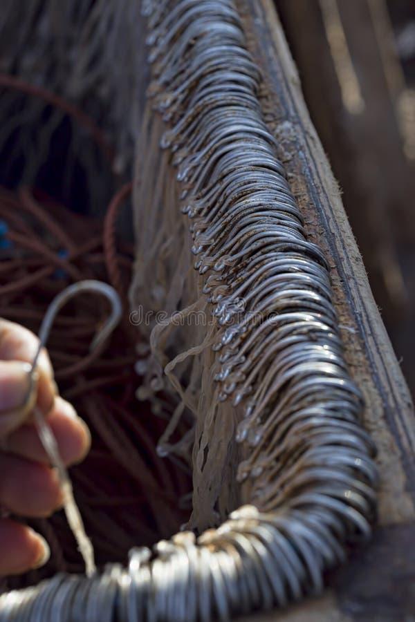Fishermen hooks. In box in fishing village stock photos