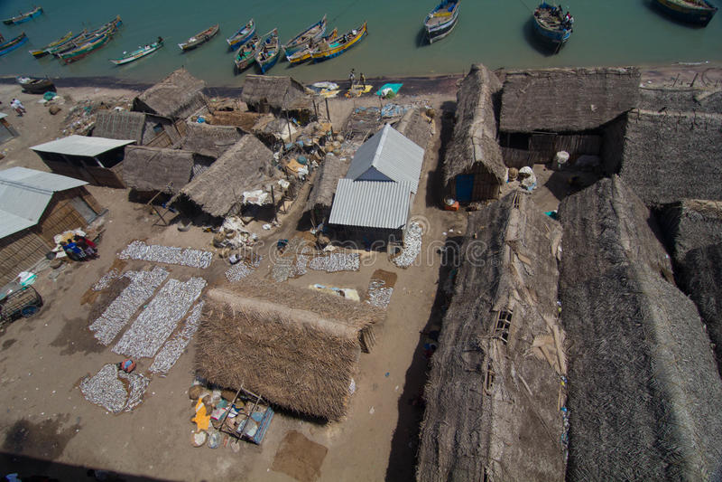 Fishermen huts and boats stock photos