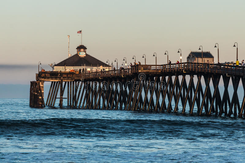 Fishermen on the Imperial Beach Fishing Pier. At dawn in San Diego, California stock photography