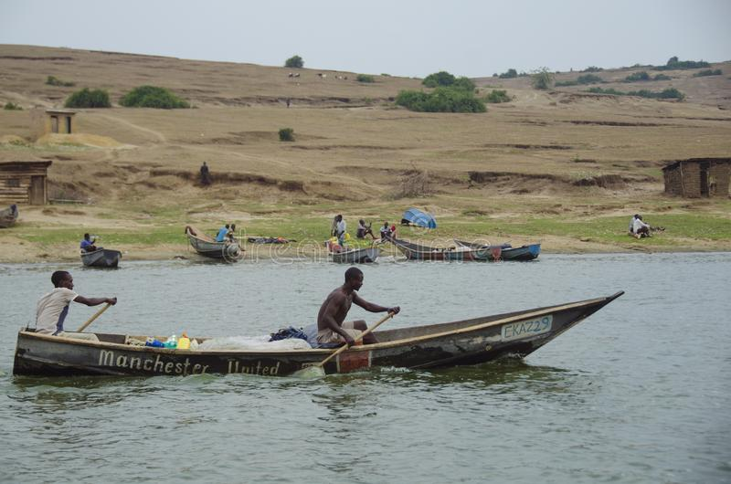 Fishermen on the Kazinga Channel shore stock image