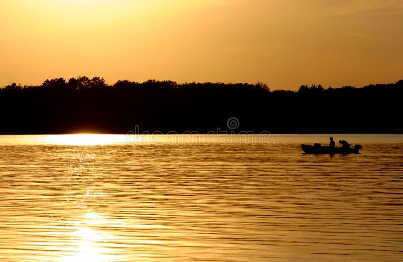 Download Fishermen on a Lake. stock image. Image of colorful, lake - 2798079