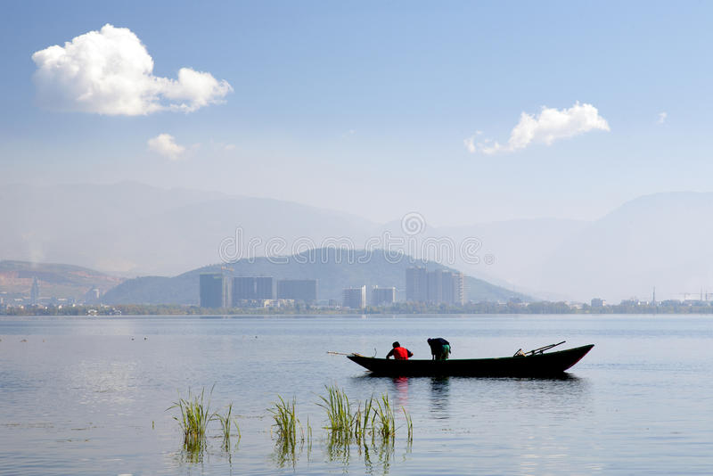 Download Fishermen On Lake In Front Of City Editorial Image - Image of fisher, province: 27752650