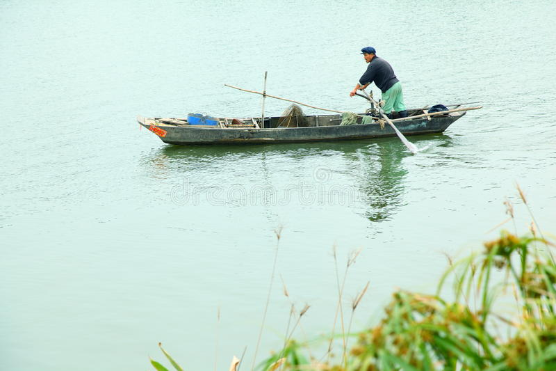 Fishermen On Little Boat Royalty Free Stock Image