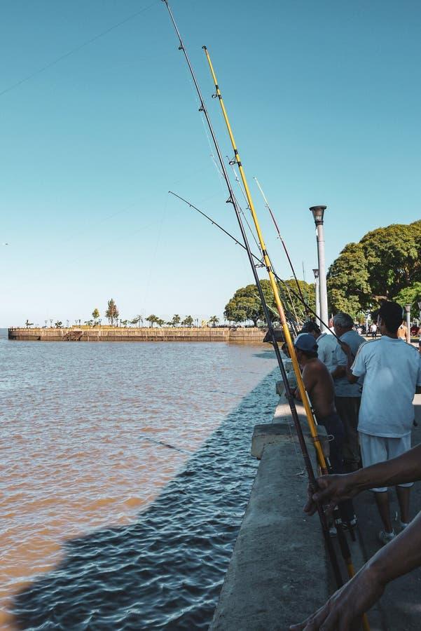Fishermen near Jorge Newbery international airport in Buenos Aires stock image