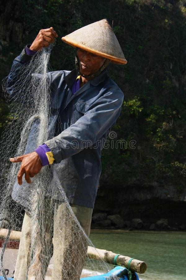 The fishermen. Ngrenehan beautiful beach located in wonosari, Yogyakarta, Indonesia stock images