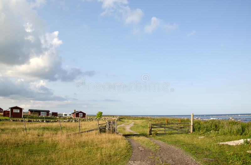 Fishermen old cabins and a gate stock images