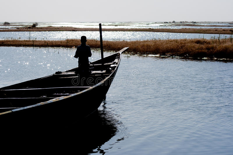 Fishermen in a pirogue in the river Niger (6). Fishermen in a pirogue in the river Niger. The Niger River is an important source of fish, providing food for royalty free stock photography