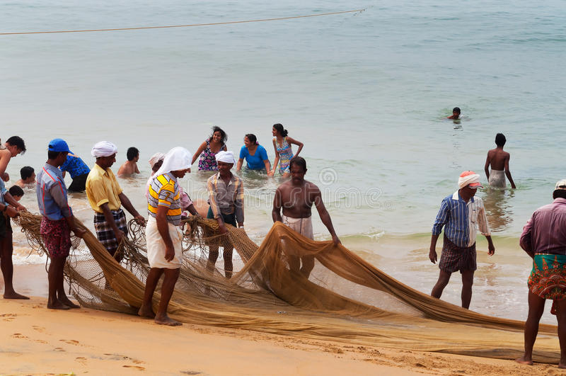 Fishermen are pull their fishing net on Samudra beach in Kovalam stock photography