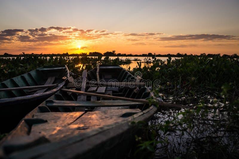 Fishermen`s boats at Rio Paraguay. Fishermen`s boats in Puerto Pollo at Rio Paraguay in Paraguay`s Pantanal at sunset royalty free stock photos