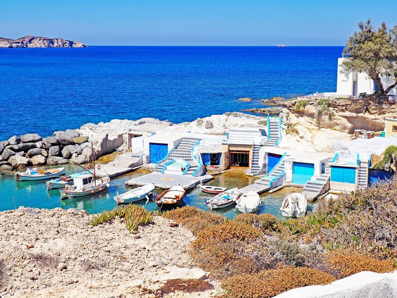 Fishermen`s huts carved into the rocky coast of Milos Island. Fishermen`s hust carved into the rocky coast of Milos Island in the Cyclades Islands of Greece royalty free stock image