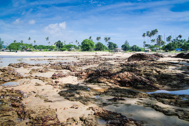 Fishermen's Village from Dungun Beach. View of rocky beach and fishermen's village at Dungun, Terengganu royalty free stock image