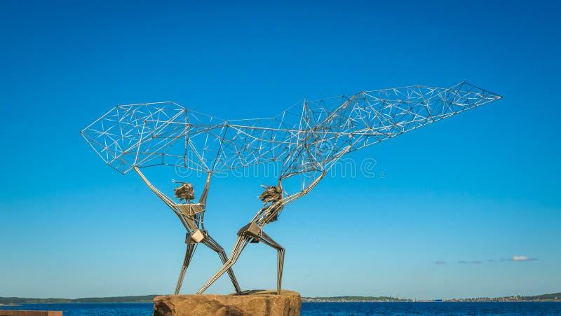 Fishermen sculpture, Onega lake embankment, Petrozavodsk, Russia stock image