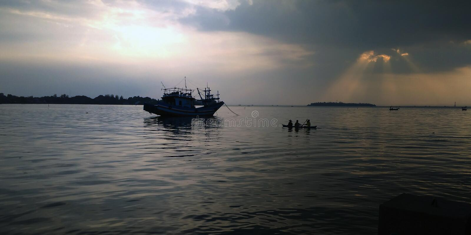 Fishermen in the sea of Jepara Indonesia. Fishermen in the Indonesian Jepara Sea will go to the high seas to find fishes royalty free stock photography