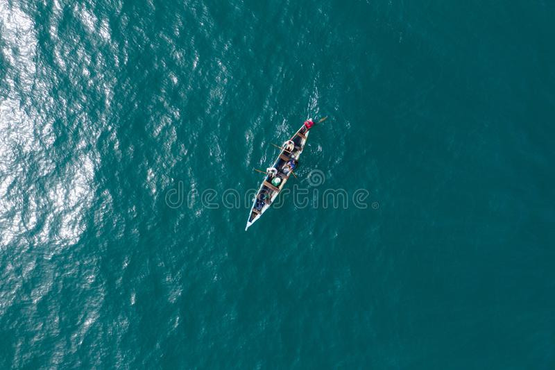 Fishermen on sea wave royalty free stock photos