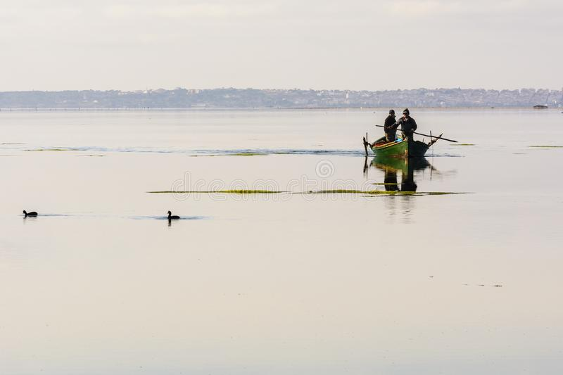 Fishermen with their ancient boats, fall at dawn. Sardinia South West royalty free stock images