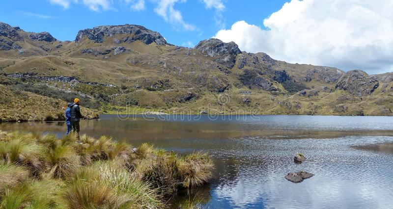 Fishermen at Toreadora lake in Cajas National Park, Ecuador stock image