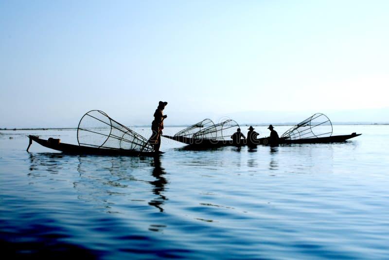 Fishermen on water. Image of fishermen on water