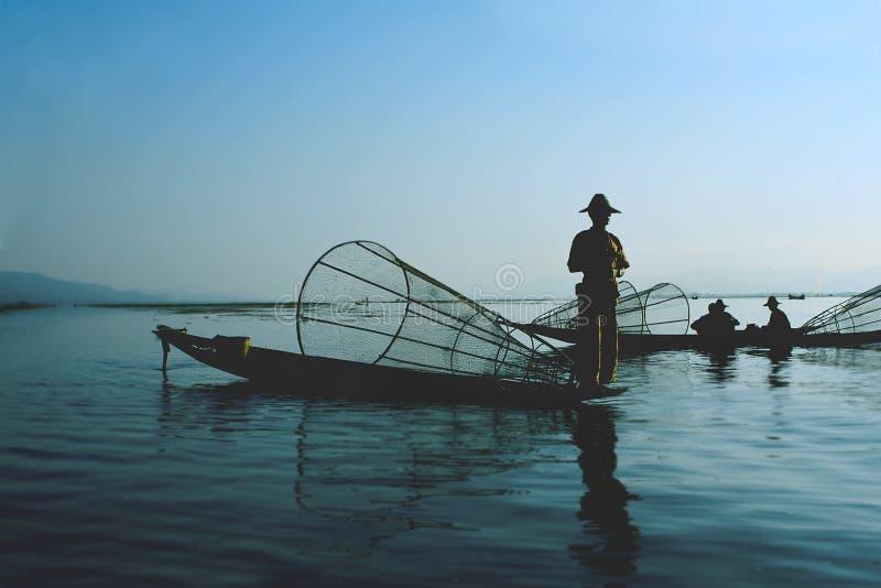 Fishermen on water royalty free stock photo