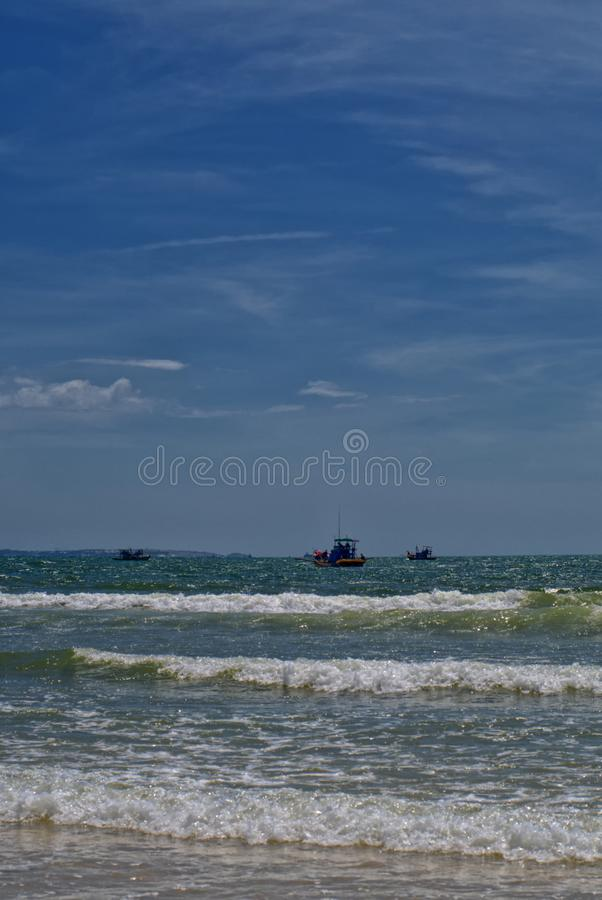 Fishermen at work in the Gulf of Mui Ne royalty free stock images